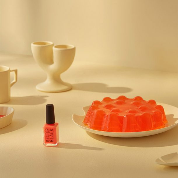 Coral Nail Polish on table with red jelly