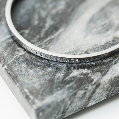 fucking fierce silver bangle on grey marble