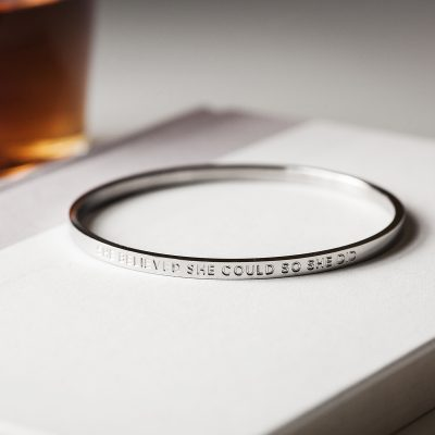 close up of silver inspirational quote bangle
