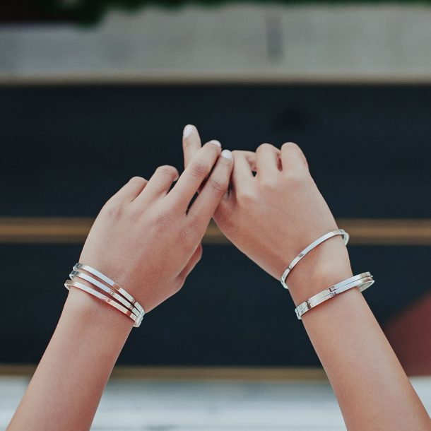 tanned women displaying her bangles