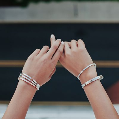tanned hands and wrists wearing bangles