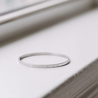 close up of let your light shine silver bangle