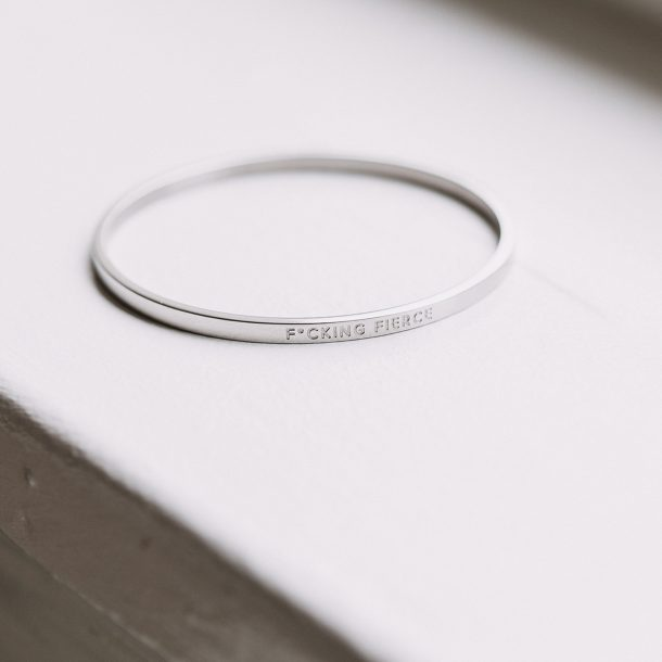 silver fucking fierce quote bangle on window seal