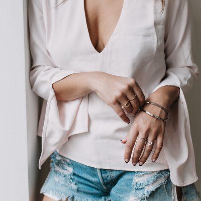 model near window wearing silver bangles