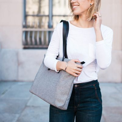 smiling women with grey bag