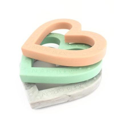 ADORE Teether stacked pink mint and marble