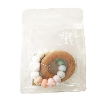 Pastel Rainbow Beech Teether in packaging