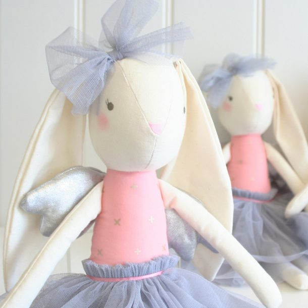 two Alimrose Silver Angel Bunny dolls sitting on a shelf