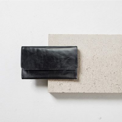 STATUS ANXIETY Black Audrey Wallet styled with cement block