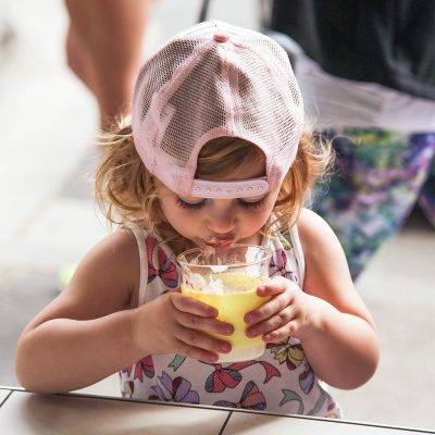 girl drinking from a Sorbet Yellow SoL Cup