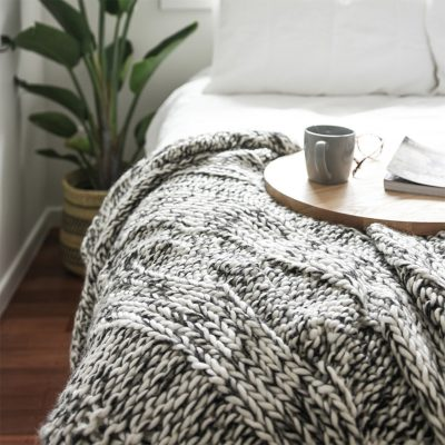 Claudette Chunky Knit Throw on bed with tea
