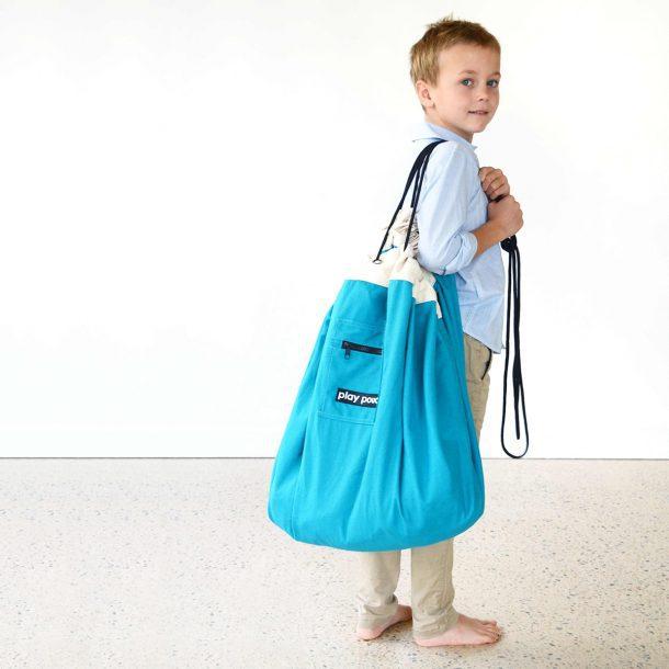 boy holding Ocean Blue Play Pouch