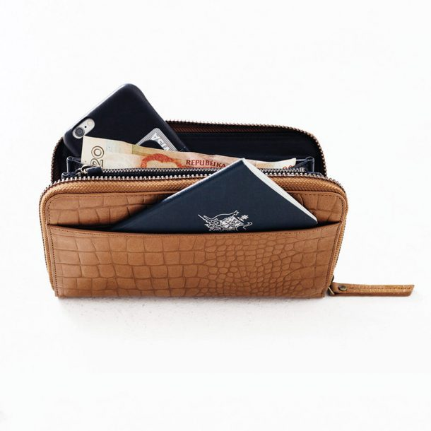 Status Anxiety Tan Croc Delilah Wallet filled with passport and phone