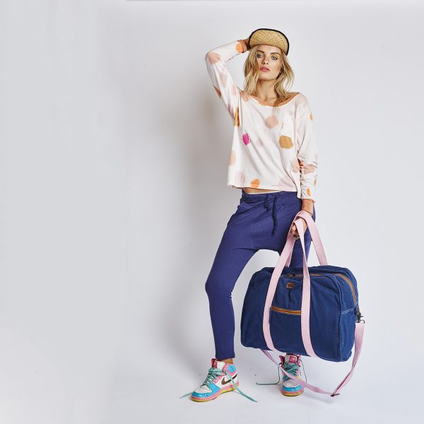 lady holding Kip&Co Large Navy Duffle Bag