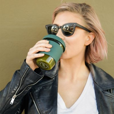 woman drinking from her Deep Sea Green SoL Cup