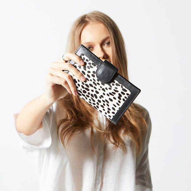 girl holding Status Anxiety Snow Cheetah Doris Wallet