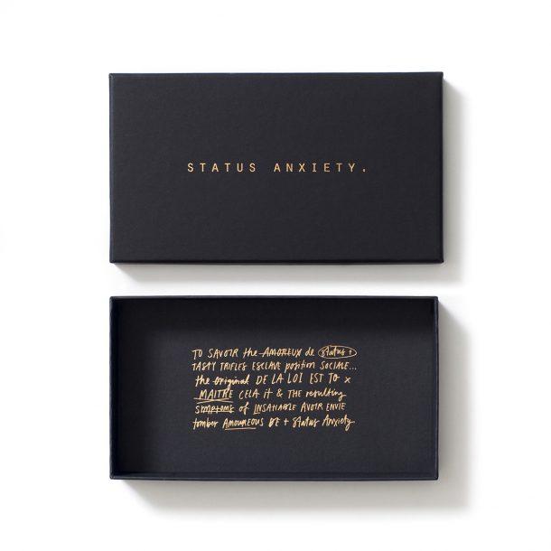 STATUS ANXIETY Wallet Packaging