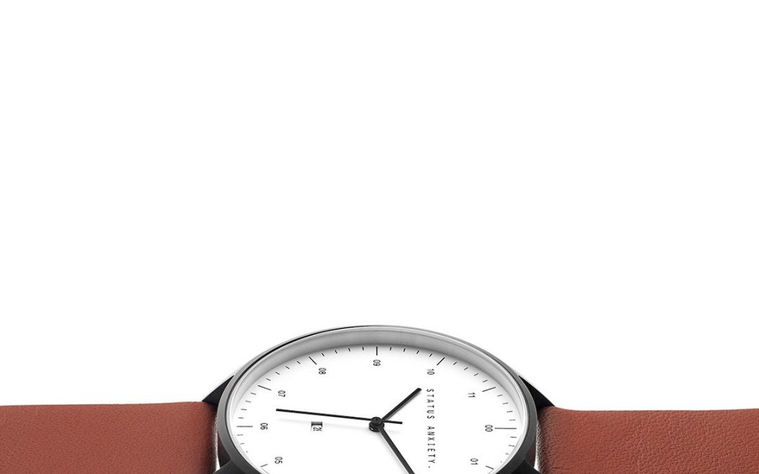 c1f3d4ed0 status-anxiety-watch-inertia-matte-black-white-face-tan-strap -side-angle_70d0.