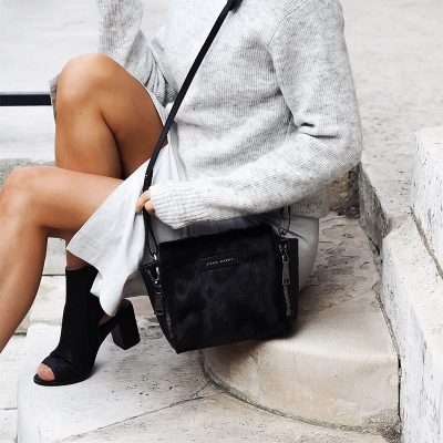 girl sitting on step with Status Anxiety Black Fur Ascendants Bag