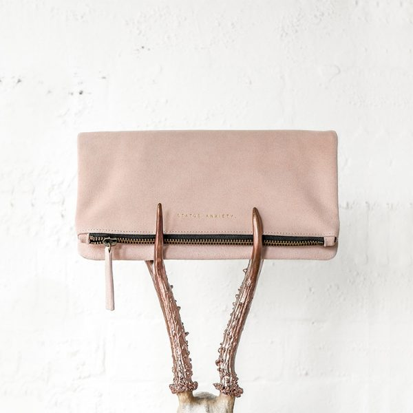Status Anxiety Dusty Pink Feel The Night Clutch on rose gold horns