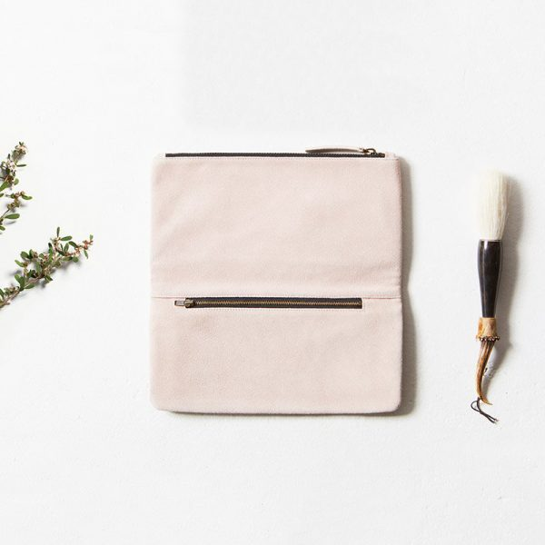 styled flat lay with Status Anxiety Dusty Pink Feel The Night Clutch
