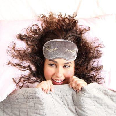 model wearing a velvet eye mask