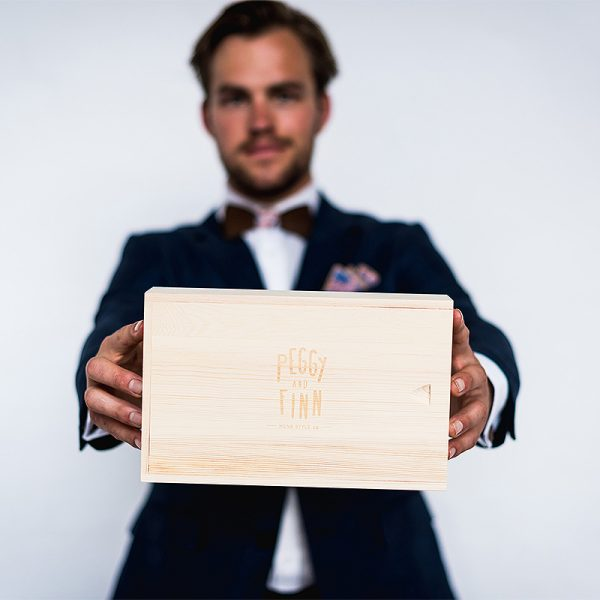 man holding wooden gift box