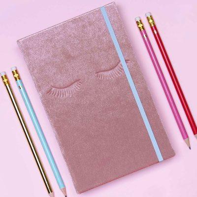 Blush Velvet Notebook with eyelashes on the cover